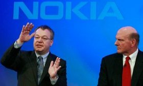 Nokia chief executive Stephen Elop watched by Microsoft chief executive Steve Ballmer